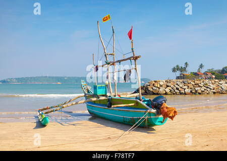 Sri Lanka - Galle, landscape with fishing boat in the port - Stock Photo