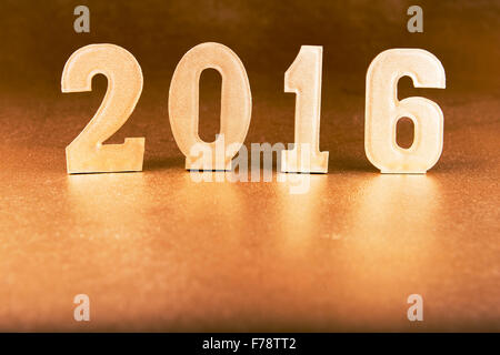 golden figures 2016 on a gold background - Stock Photo
