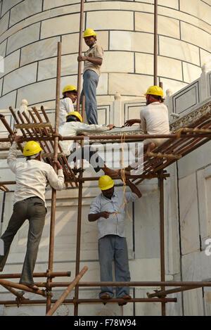 Manual worker repair on the Taj Minaret at Taj Mahal,Agra uttar Pradesh,India - Stock Photo