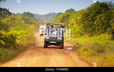 Jeep off road safari in the Yala National Park, Sri Lanka - Stock Photo
