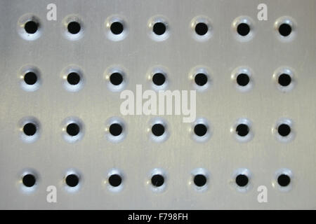 shiny brushed Metal surface with holes - Stock Photo