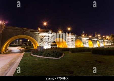 Night image of a Toledo bridge over a Manzanares river  in Madrid - Stock Photo