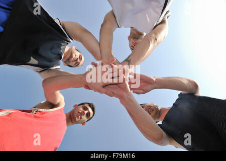basketball player team group  posing on streetbal court at the city on early morning - Stock Photo