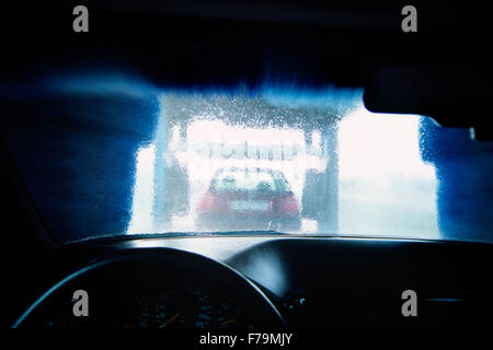 Water in Carwash Splashing on Car Window - Stock Photo