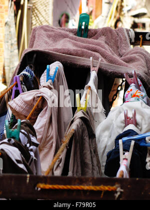 Cloths hanging on rope over balcony - Stock Photo
