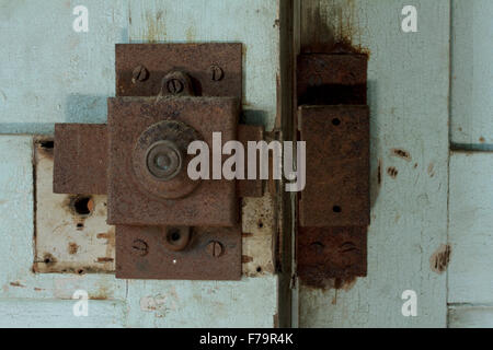 The rusty door lock from the 1st floor's twin-folded doors leading to the room hosting all wallpaintings by Manos - Stock Photo