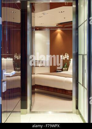 View through bedroom doorway in luxury SKY Yacht. - Stock Photo
