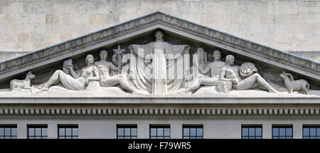 The decorated pediment exterior of Victoria House, Bloomsbury, London - Stock Photo