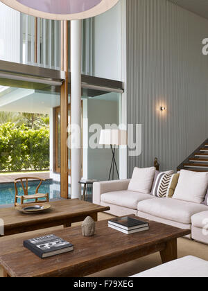 Interior and view over pool and terrace of a house in Cove Way, Sentosa, Singapore designed by Robert Greg Shand - Stock Photo