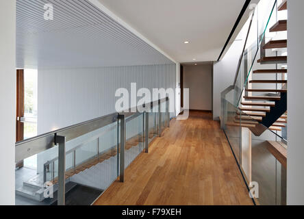 Stairway and elevated walkway landing of a house in Cove Way, Sentosa, Singapore designed by Robert Greg Shand Architects - Stock Photo