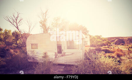Vintage stylized picture of old trailers, USA countryside. - Stock Photo