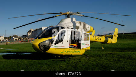 Essex and Herts air ambulance trust helicopter at bathhouse meadow Walton on the Naze - Stock Photo