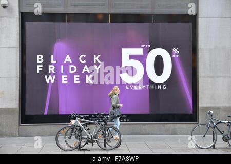 Oxford Street, London, UK. 27th November 2015. Black Friday: sale signs in shop windows on Oxford Street in London - Stock Photo