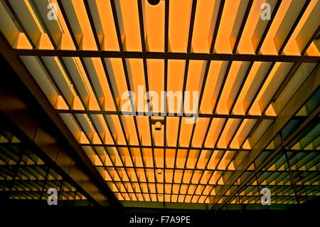 Open roof of a modern building with long strip made from steel pipe - Stock Photo