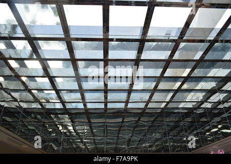 A open roof-top strip pattern with beautiful blue sky in background - Stock Photo