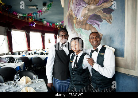 Waiters at the Roma Revolving Restaurant in Durban South Africa. - Stock Photo