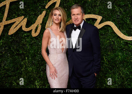 Rosie Huntington-Whiteley and Mario Testino at the British Fashion Awards 2015 in London - Stock Photo