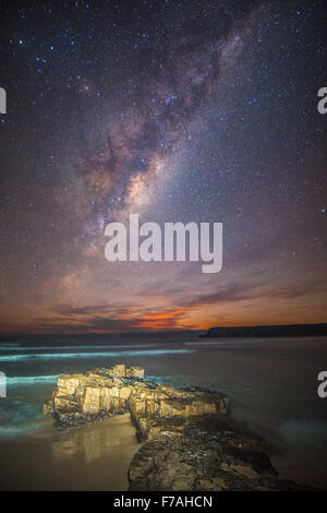 Moonrise under the milky way - Stock Photo