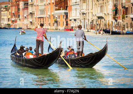 Grand Canal (Canal Grande) - two venetian gondola with tourists, Venice, Italy - Stock Photo