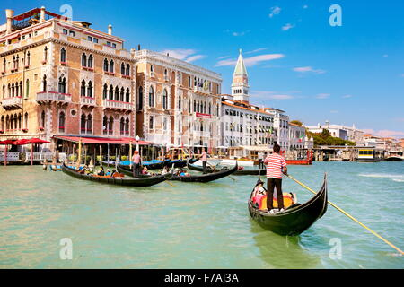 Gondolier flowing gondola, Grand Canal (Canal Grande), Venice, Veneto, Italy, UNESCO - Stock Photo