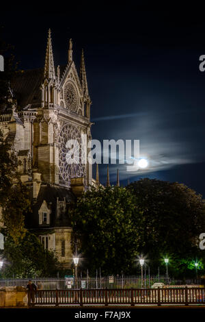 Full Moon Rising Behind Notre Dame, Paris France - Stock Photo