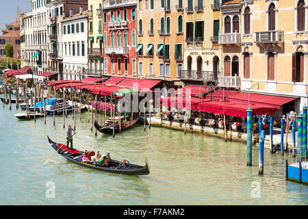 Venice view from the Rialto Bridge - gondola with tourists on the Grand Canal, Venice, Italy - Stock Photo