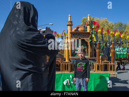 Woman Taking Picture In Front Of A Trolley Where Are Sold Green Ribbons During Ashura Celebration, Kurdistan Province, - Stock Photo
