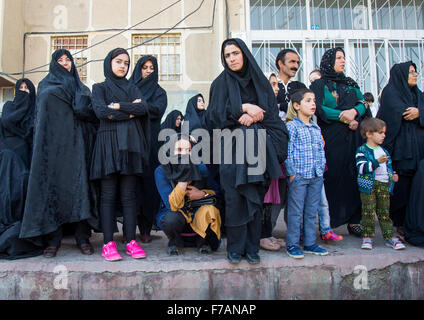 Iranian Shiite Muslims Women And Children Watching The Ashura Parade, The Day Of The Death Of Imam Hussein, Kurdistan - Stock Photo