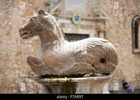Horse fountain near Cathedral of St. Nicola, Taormina old town, Sicily, Italy - Stock Photo