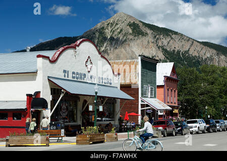 Historic Downtown, cyclist and Mount Crested Butte (12,162 ft.), Crested Butte, Colorado USA - Stock Photo