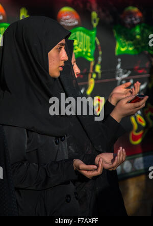 Iranian Shiite Muslims Women Praying During Ashura Celelbrations, The Day Of The Death Of Imam Hussein, Kurdistan - Stock Photo