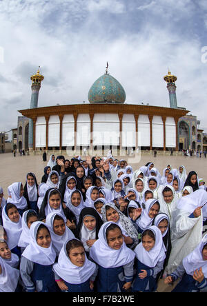 Veiled Muslim Shiite Schoolgirls In Front Of The Shah-e-cheragh Mausoleum, Fars Province, Shiraz, Iran - Stock Photo