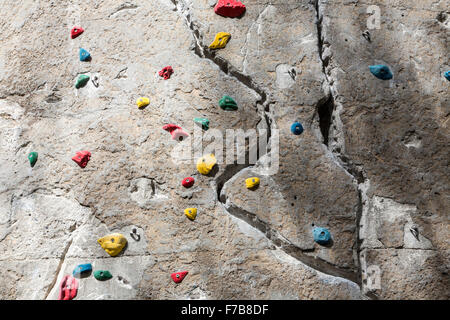 climbing wall with climbing holds for different climbing routes, - Stock Photo