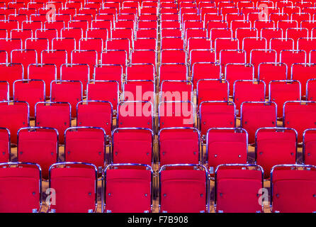 Red chairs, many rows, in an auditorium, theater, - Stock Photo