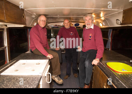 3 of the four surviving team of 9 who embarked on a 3-year round the world tour in 1969 on a 1948 Leyland bus... - Stock Photo