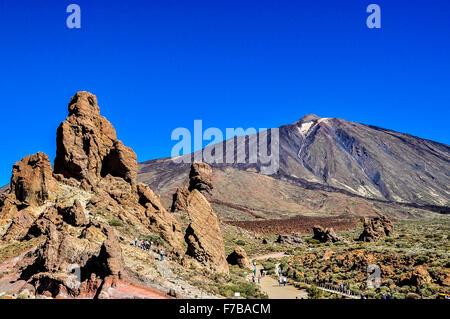 El Teide volcano, 'The Finger of God', Roques de Garcia and tourists - Stock Photo