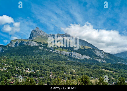 Mont Blanc Massif, France, Haute Savoie, Megeve grass and sky green ,no snow,clouds,blue sky - Stock Photo