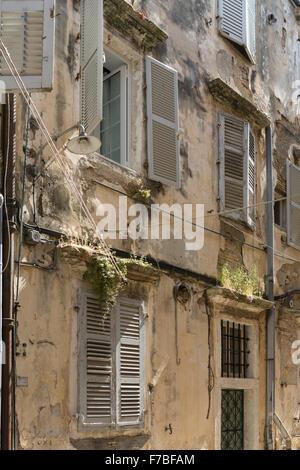 Greek apartments in a back street in Corfu Town. Corfu - Stock Photo