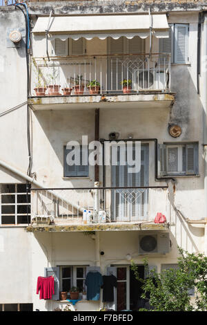 Apartments in a back street in old Corfu Town. Corfu - Stock Photo