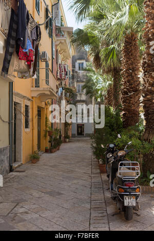 Mopeds and washing in a back street in old Corfu Town. Corfu - Stock Photo