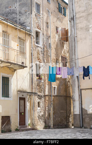 Old buildings in a square in back streets in Corfu Town. Corfu - Stock Photo