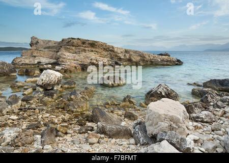 Rocks on the beach at Kassiopi - Stock Photo