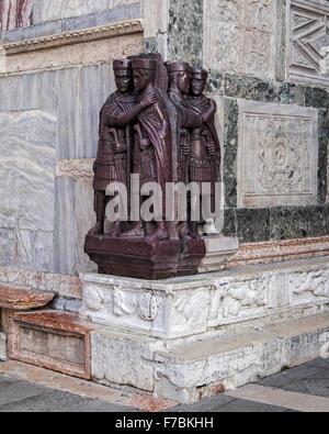 Venice, Italy, Piazza San Marco. Porphyry statue of Tetrarchs, four emperors outside the Basilica di San Marco - Stock Photo