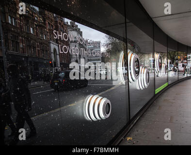 white round circle Christmas decorations with the street reflection on it at one of Sloan Square Shopping centers, - Stock Photo