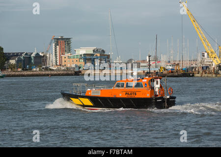 Orange and Black pilot boat crossing Portsmouth harbour at speed. - Stock Photo