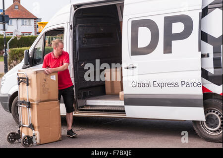 A DPD delivery driver delivering parcels  in Southwold , Suffolk , England , Britain , Uk