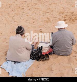 A couple enjoying the beach in Southwold , Suffolk , England , Britain , Uk - Stock Photo