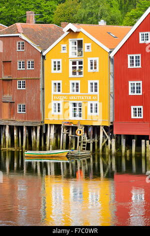 Stilt colorful historic storage houses in Trondheim, Norway - Stock Photo