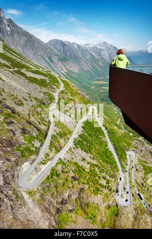 Tourist on the viewing platform, Trollstigen high mountain road, Norway - Stock Photo