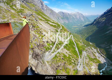 Tourist on the viewing platform, Trollstigen near Andalsness, Norway - Stock Photo